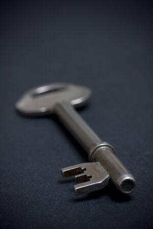 door key on dark background