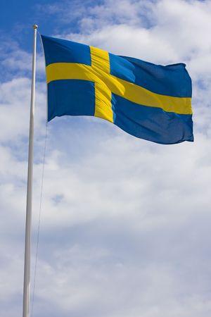swedish: Swedish flag on sky background