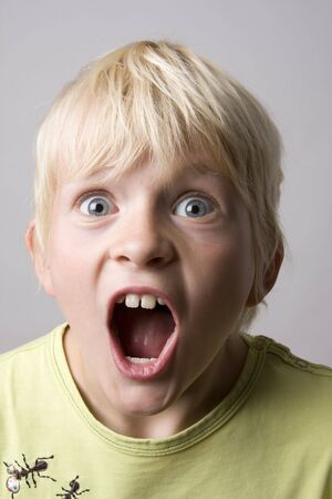 hilarious: Portrait of a young boy shouting madly
