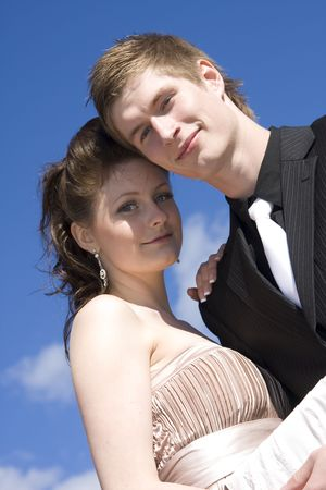 young beautiful happy couple on sky background photo
