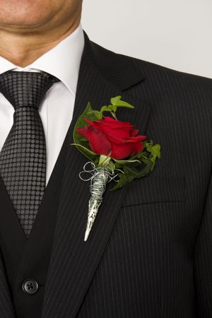 red rose on suit jacket of groom