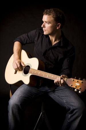 ballad: young musician playing a guitar Stock Photo