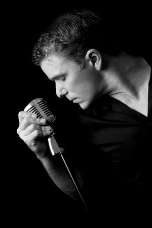 portrait of young musician holding his microphone