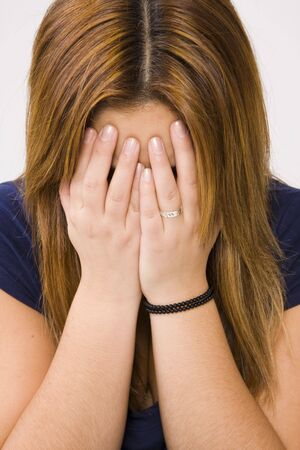 young depressed woman crying on white background Stock Photo - 3659545