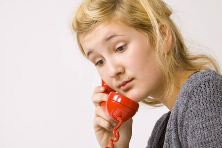 beautiful young girl and vintage red telephone photo