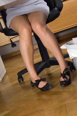 businesswoman legs: secretary legs under the table