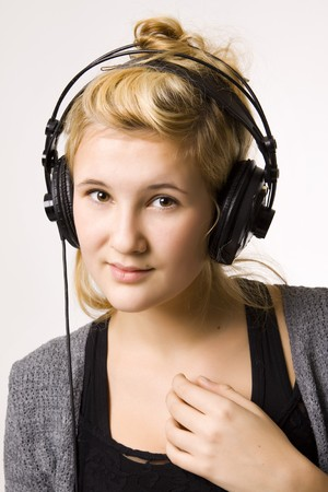 Young woman listening to music in headphones photo