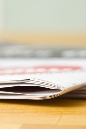 newspaper on wooden table Stock Photo - 4390571