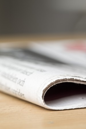 newspaper on wooden table Stock Photo - 4390572
