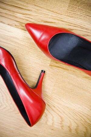 entice: fashionable female shoes on wooden floor Stock Photo
