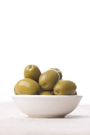 bowl full of green greek olives - healthy eating Standard-Bild
