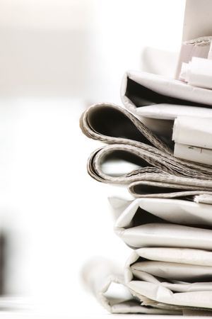 pile of newspapers on the table
