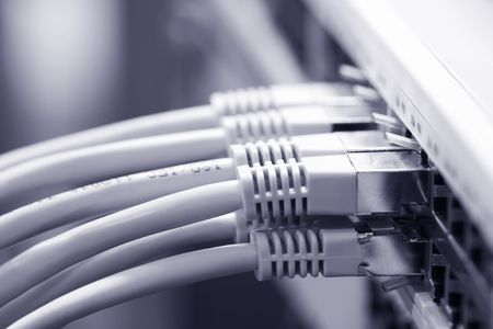 Network cables connected to a switch Standard-Bild