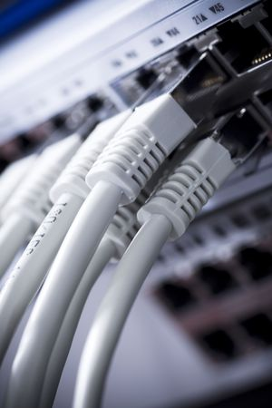 Network cables connected to a switch Stock Photo