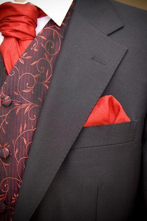 suit jacket of groom and red cravat ascot tie Standard-Bild