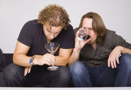two friends drinking at home (grimacing) photo
