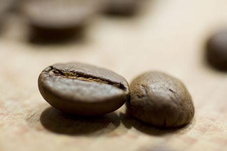 caf: coffee beans on wooden background