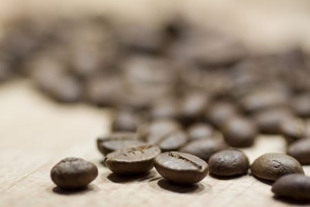 caf: caffe beans on wooden background Stock Photo