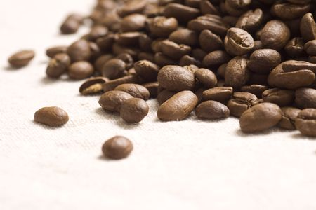 coffeebeans: Roasted coffee beans on jute sacking Stock Photo