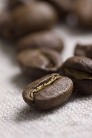 Roasted coffee beans on jute sacking Stock Photo