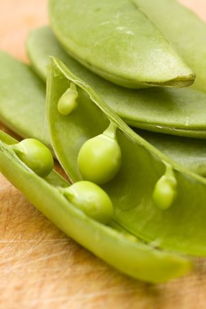 close-up fo opened green bean pod with selective focus on wooden background Stock Photo - 5943716