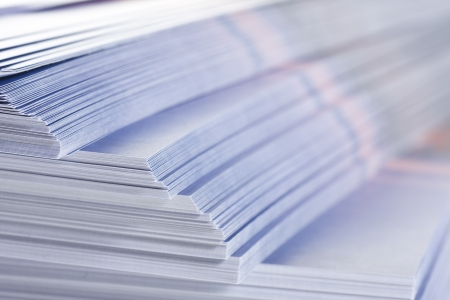 printed material: stack of flyers, selective focus