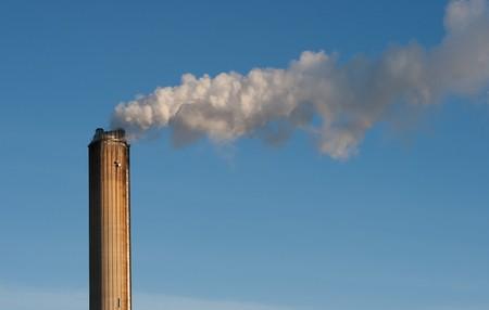 industrial smokestack on sky background photo