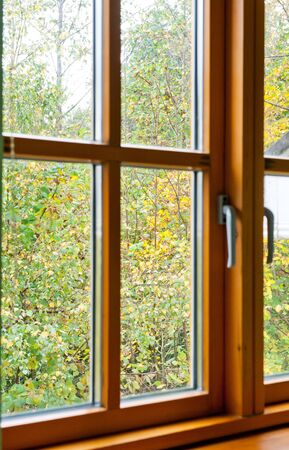 Double glazed wooden window frame in the home in the autumn season