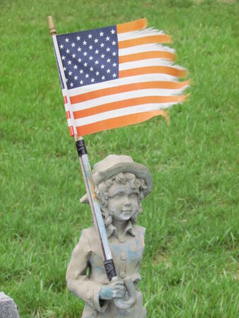 Soldier Girl with Flag Standing Post at Grave