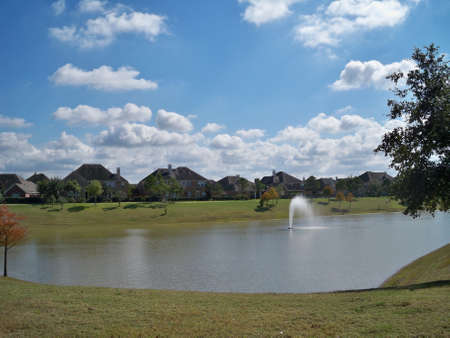 An image of a lake in a residential neighborhood.