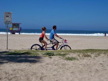 seater: An image of a tandem bike riders at Venice Beach California 03-10-2008 Editorial