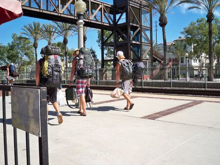 orange county: FULLERTON, CALIFORNIAUSA – March 8: Three young men walking on train station platform on March 8, 2008.
