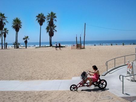 VENICE BEACH, CALIFORNIAUSA – MARCH 10: A woman riding a trike bicycle at Venice Beach California on March 10, 2008.