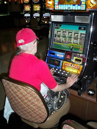 slot machines: HENDERSON, NEVADAUSA - April 3: An image woman playing the slot machines at Green Valley Ranch Casino on April 3, 2008. Editorial