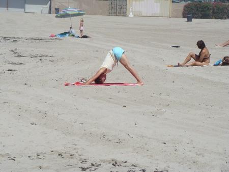 VENICE BEACH, CALIFORNIAUSA – MARCH 10: An image of a woman doing yoga at Venice Beach California on March 10, 2008.