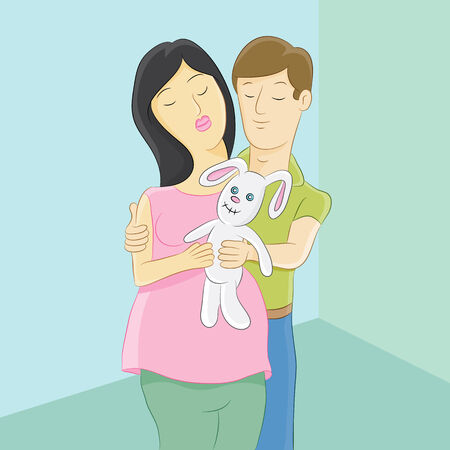 An image of an expectant mother and husband holding a baby toy.