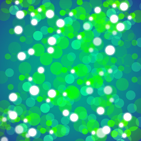 An image of a background of green blurred lights.
