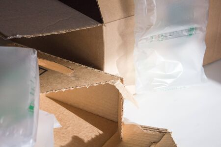 material: An image of empty boxes and packing material.