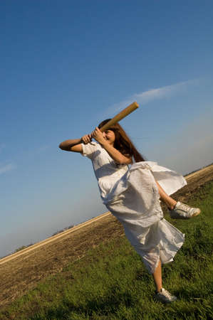 girl with baseball bat in the field Stock Photo - 3765977