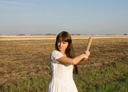 girl with baseball bat in the field Stock Photo - 3788947