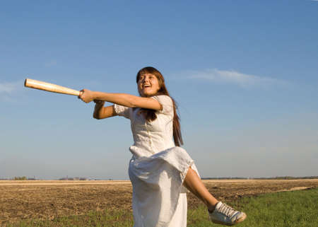 girl with baseball bat in the field Stock Photo - 3788936