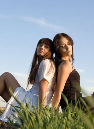 Two beautiful girls on the green grass Stock Photo - 3788931