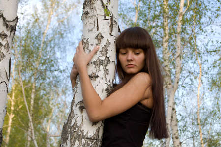 european white birch: Beauty young sexy girl hugging the birch
