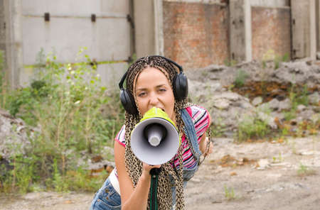 Beautiful girl singing with the megaphone photo