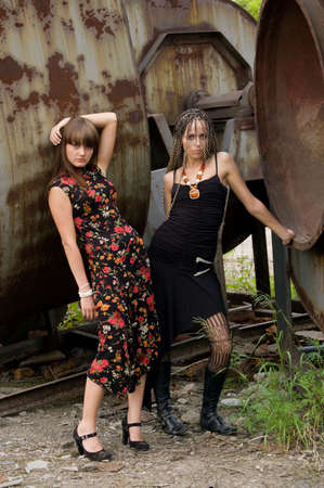 florets: two fashionable girls on the dirty industrial place alongside of constructions