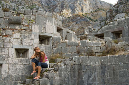 provincial: beauty girl on stair beside fortress in the Montenegro Stock Photo