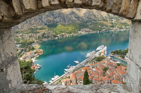 provincial town with little houses and dock in Montenegro Stock Photo