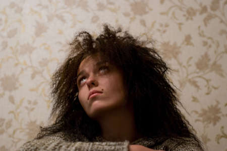 frizz: beauty girl with frizzle hair looking up and dreaming Stock Photo