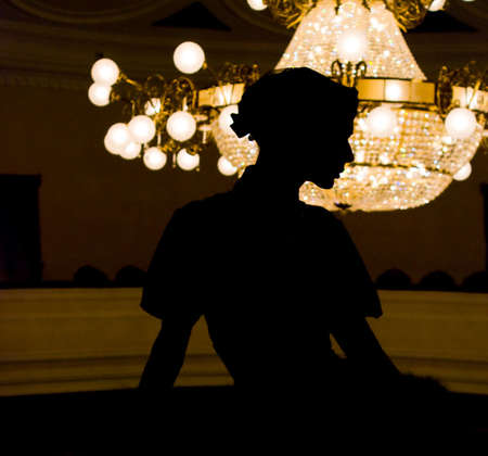 silhouette of beauty girl in the theater