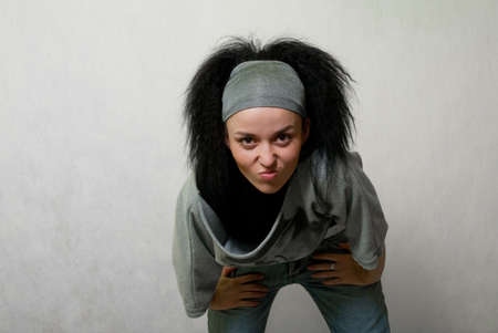 frontlet: beauty frown girl stay on gray background Stock Photo